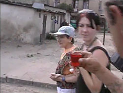 The family is offered a drink in the neighborhood where the Lodz Ghetto stood.